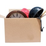 A Genuine Box of used items ready for a garage sale, Yard Sale,